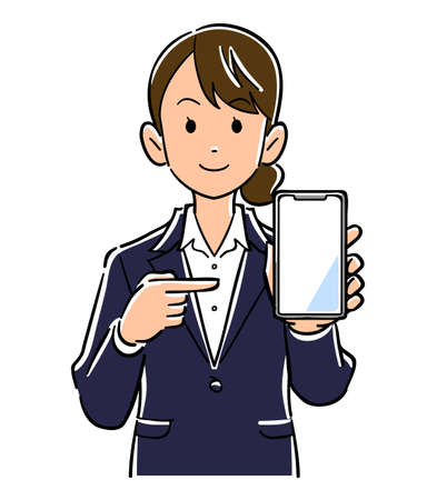 A woman in a suit holding a smartphone and pointing at the screen