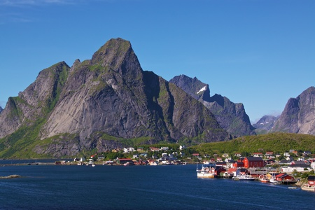 Reine - scenic fishing village on Lofoten Islands in summer, during polar day photo