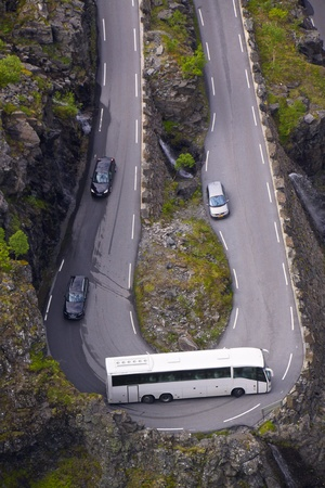 hairpin: Coach having trouble with turning in sharp hairpin on Trollstigen Pass in Norway