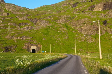 single lane road: Uttakleivveien, single lane road on Lofoten Islands leading into narrow tunnel