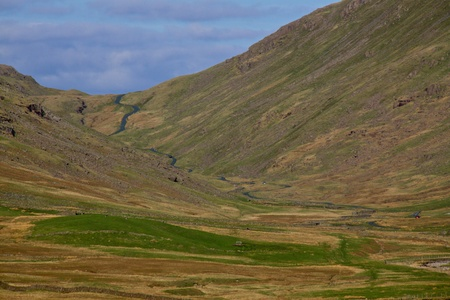 View towards Wrynose Pass in Cumbria, one of the highest mountain passes in England photo