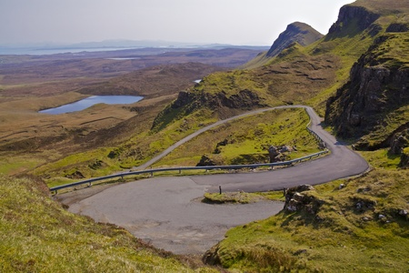 Road climbing up into the hills on Isle of skye photo