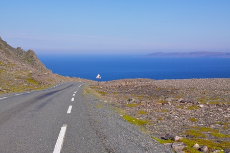 Road in Varanger, extreme north of Norway during summer with Barents Sea in the view Stock Photo - 11868581