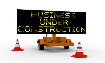 Signboard on the top of a roadworks cart saying Business under construction