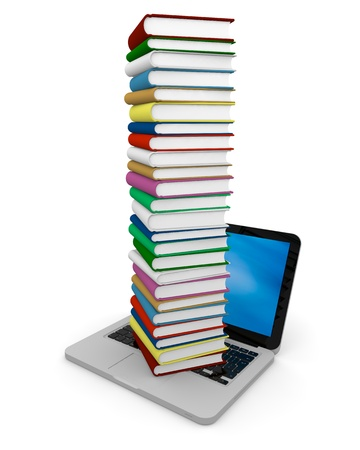 Tall pile of colourful books on the top of a laptop