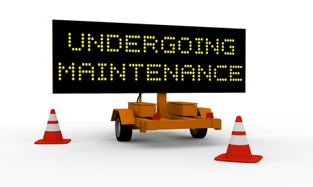 updating: Black signboard on the top of a roadworks cart saying Undergoing maintenance Stock Photo