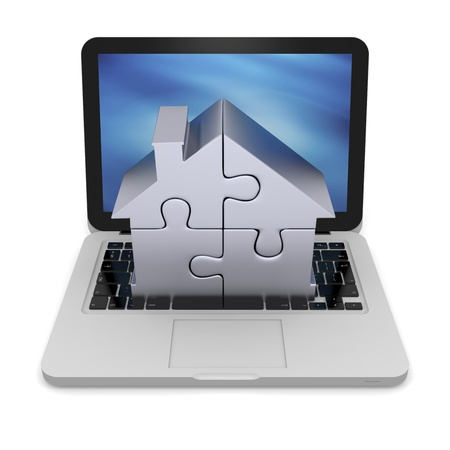 House symbol made of four silver puzzle pieces on laptop photo