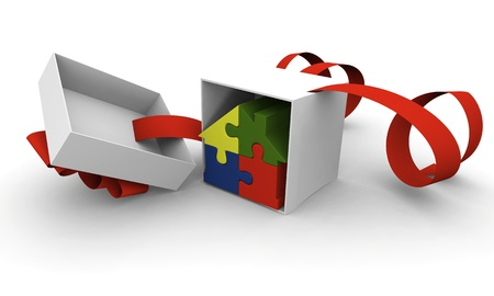 House symbol made of four colorful puzzle pieces inside gift box photo