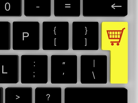 Symbol of shopping trolley on yellow key on keyboard Stock Photo - 12454957