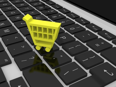 Yellow shopping trolley symbol on a computer keyboard Stock Photo - 12454979
