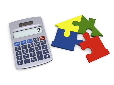 Calculator with colorful house jigsaw being completed photo