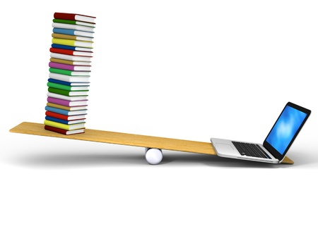 Laptop and books balancing with laptop being heavier Standard-Bild
