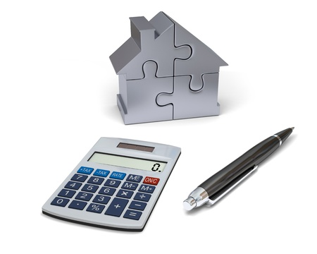 Concept of house financing with calculator, pen and silver model of house made of jigsaw pieces photo