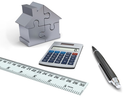 evaluating: Concept of house financing with calculator, pen, ruler and silver model of house made of jigsaw pieces