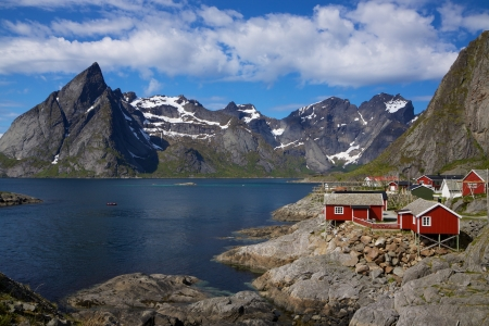 Picturesque fishing village on the coast of fjord on Lofoten islands in Norway photo