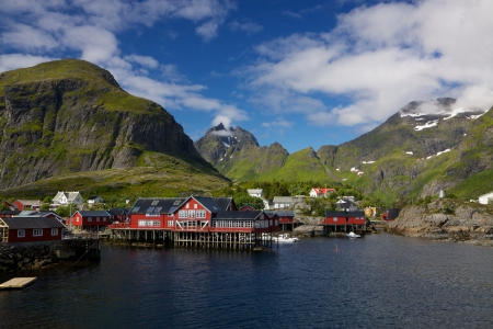 Picturesque village on Lofoten islands in Norway surrounded by mountains photo