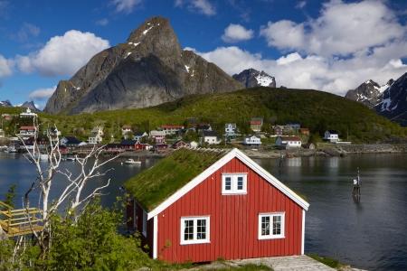 Scenic rorbu hut with sod roof in town of Reine on Lofoten islands in Norway