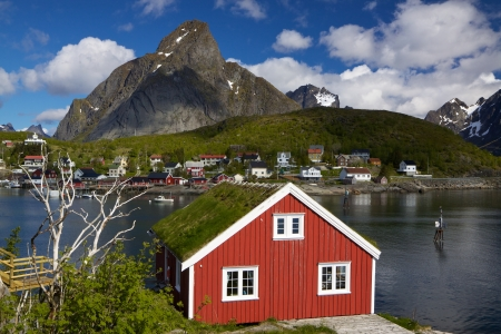 Scenic rorbu hut with sod roof in town of Reine on Lofoten islands in Norway