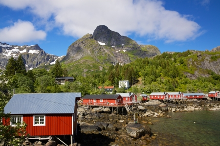 rorbu: Typical red rorbu fishing huts with sod roof on Lofoten islands in Norway Stock Photo