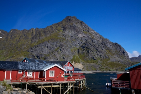 rorbu: Typical red rorbu fishing huts by fjord on Lofoten islands in Norway