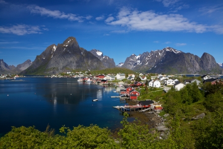 fishing industry: Picturesque town of Reine by the fjord on Lofoten islands in Norway, famous tourist destination