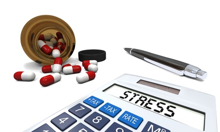 Anti-stress pills in opened pill bottle with calculator and pen isolated on white background photo