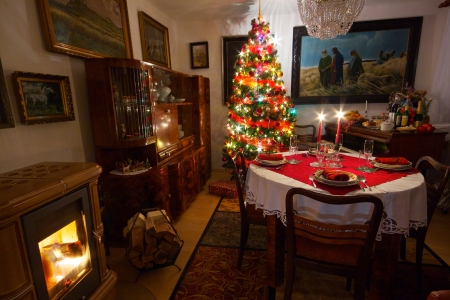 Cozy room with decorated Christmas tree, old piano, fireplace and table ready for Christmas dinner Stock Photo - 15129780