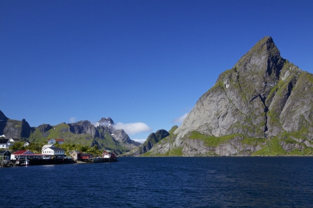 Picturesque panorama of mountain peaks around fjord on Lofoten islands in Norway photo