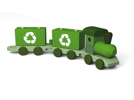 Green toy train with recycling symbols, concept of environmental protection as part of early children education, isolated on white background photo