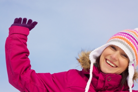 Smiling attractive girl wearing knitted winter cap photo