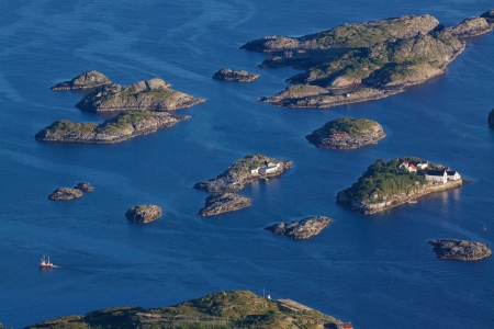 islets: Bird eye view of fishing boats sailing between scenic islets near Henningsvaer on Lofoten islands in Norway Stock Photo