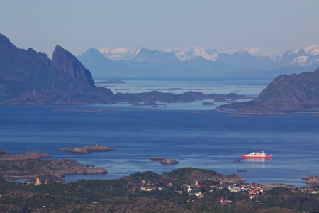 Ferry leaving town of Svolvaer on Lofoten islands in norway with scenic panorama photo