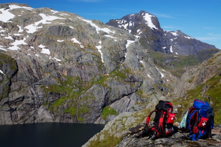 Picturesque scenery on Lofoten islands in Norway with two backpacks photo