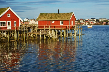 rorbu: Traditional red rorbu huts with green roofs in fishing town of Reine on Lofoten islands in Norway