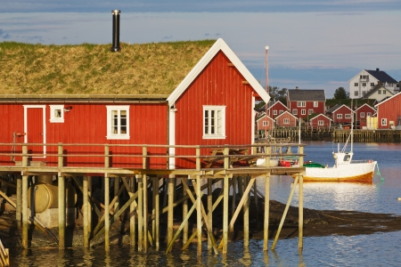 rorbu: Typical red rorbu hut with turf roof in town of Reine on Lofoten islands in Norway