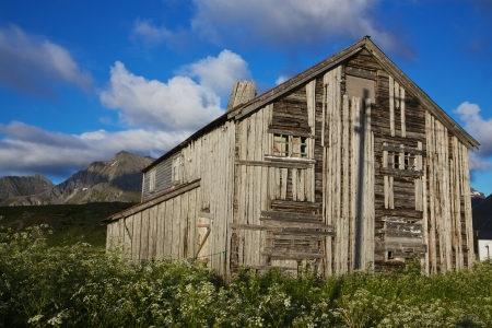deteriorated: Old deteriorated wooden farm house in picturesque nature in Norway