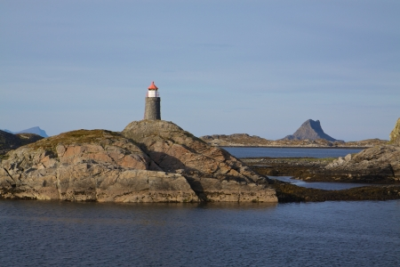 islets: Rock islets with lighthouse on Lofoten islands in norway