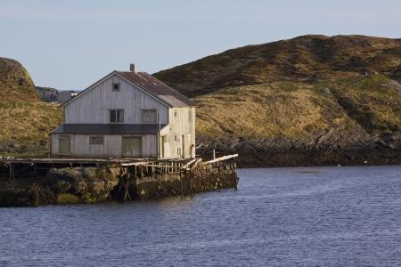 Old abandoned wooden house on norwegian coast photo