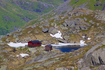Scenic norwegian mountain hut on Lofoten islands photo