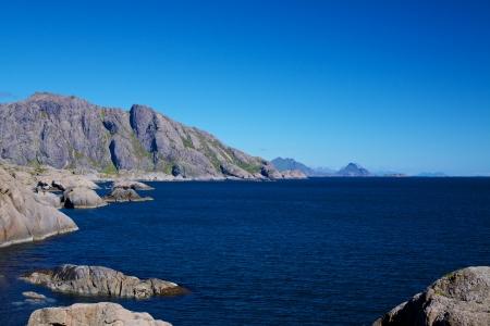 Rocky norwegian coastline on Lofoten islands in summer Stock Photo