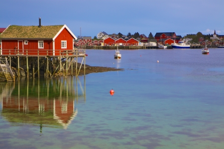 rorbu: Typical red rorbu hut in fishing harbour in scenic town Reine on Lofoten islands in Norway