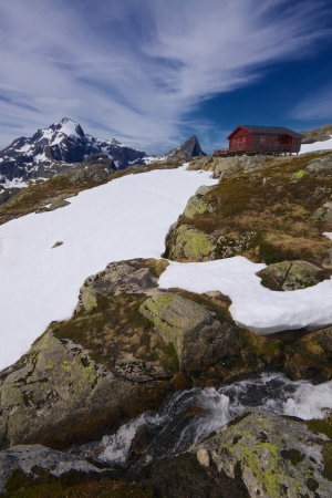 Picturesque norwegian mountain cabin on Lofoten islands in Norway during summer