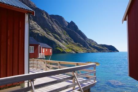 rorbu: Traditional norwegian red rorbu huts in fjord on Lofoten islands in Norway