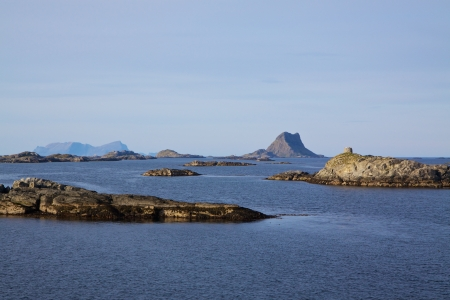 islets: Rocky islets on norwegian coast on sunny summer day near Lofoten islands