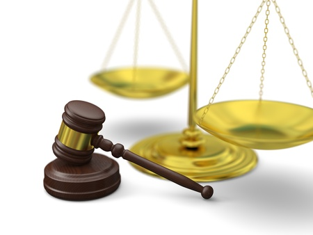 Golden scale and gavel on white background, symbols of law and justice photo
