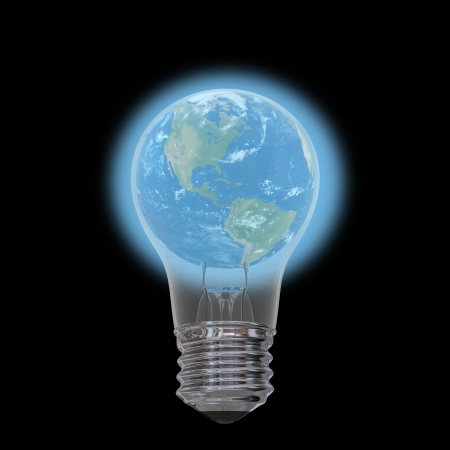 Planet Earth inside lightbulb isolated on black background photo