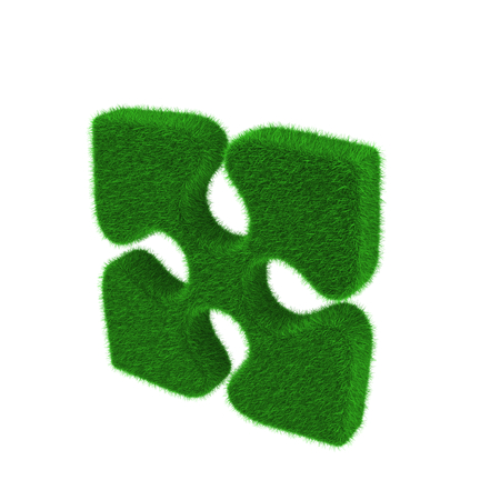 Green puzzle piece made of grass isolated on white background photo