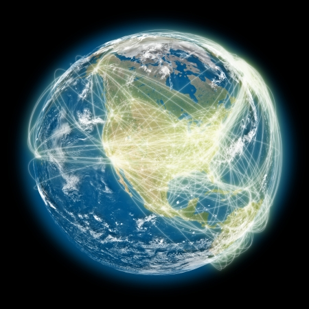 North America on planet Earth with connections between cities and continents representing global airline networks.  photo