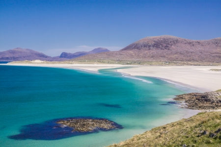 Picturesque empty white sand beach on Isle of Lewis in Scotland