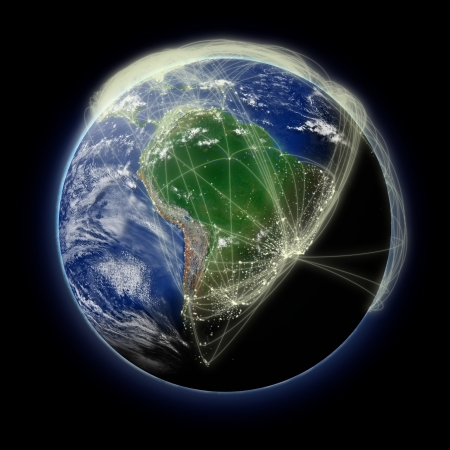 Network of flight paths over South America on blue planet Earth isolated on black background. Highly detailed planet surface.  photo